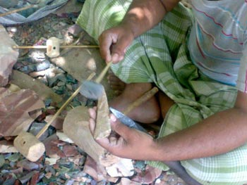 Expert Knapper Shaping a Stone