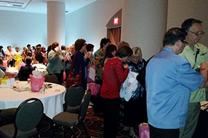 Attendees Pick Up Their Auction Winnings At The Bead Social