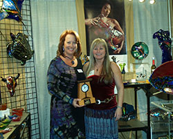 Nancy Vince poses with Karen Ehart, recipient of the Best Booth Award at ACRE Las Vegas.