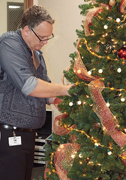 Tim C. Adding Some Final Touches To The Tree