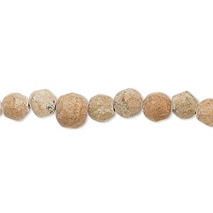 Bead, grain stone (natural), matte, 6-7mm faceted round, C- grade, Mohs hardness 3. Sold per 15-inch strand.