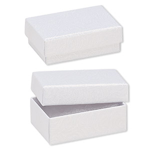 Box, paper, cotton-filled, white, 2-5/8 x 1-1/2 x 1-inch textured rectangle. Sold per pkg of 100.