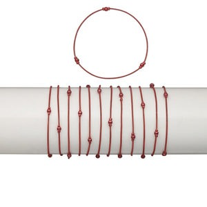 Bracelet, stretch, plastic and brass, metallic red, coil with 2.5mm and 4mm round, 7 inches. Sold per pkg of 12.