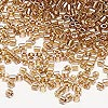Seed bead, Delica®, glass, color-lined golden rose, (DBL901), #8 round. Sold per 7.5-gram pkg.