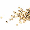 Seed bead, Delica®, glass, opaque bright 24Kt gold-finished, (DB31CUT), #11 cut. Sold per pkg of 50 grams.