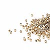 Seed bead, Delica®, glass, opaque light 24Kt gold-finished, (DB34CUT), #11 cut. Sold per pkg of 50 grams.