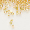Seed bead, Delica®, glass, transparent rainbow light topaz yellow, (DB100), #11 round. Sold per pkg of 50 grams.