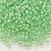 Seed bead, Dyna-Mites™, glass, inside color mint green, #8 round. Sold per 1/2 kilogram pkg.