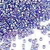 Seed bead, Dyna-Mites™, glass, silver-lined rainbow blue, #11 round with square hole. Sold per 1/2 kilogram pkg.