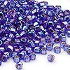 Seed bead, Dyna-Mites™, glass, silver-lined rainbow blue, #6 round with square hole. Sold per 1/2 kilogram pkg.