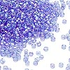 Seed bead, Dyna-Mites™, glass, transparent rainbow medium blue, #11 round. Sold per 1/2 kilogram pkg.