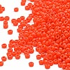 Seed bead, Miyuki, glass, opaque orange, (#406), #15 rocaille. Sold per 250-gram pkg.