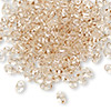 Seed bead, Preciosa Twin™, glass, crystal honey, 5x2.5mm oval with 2 holes. Sold per 10-gram pkg.