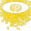 Seed bead, Preciosa Twin™, glass, transparent yellow terra pearl, 5x2.5mm oval with 2 holes. Sold per 10-gram pkg.