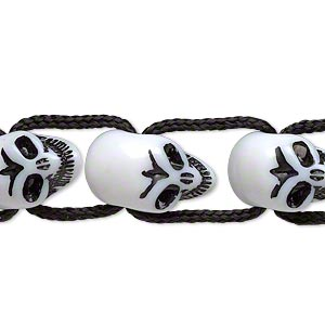 bead, acrylic, black and white, 17x10mm skull. sold per 8-inch strand.