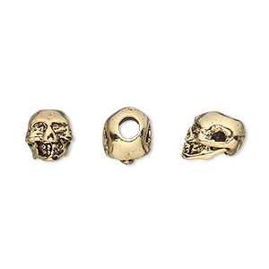 bead, antique gold-plated pewter (tin-based alloy), 9x8mm skull with 3mm hole. sold per pkg of 2.