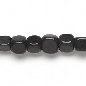 bead, blackstone (dyed), 7x7mm-9x8mm tumbled cube, c grade, mohs hardness 6-1/2 to 7. sold per 15-inch strand.