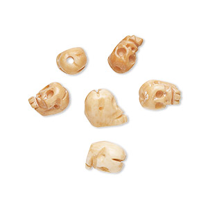 bead, bone (dyed), antiqued brown, 8x6mm-9x6mm graduated hand-carved single-sided skull, mohs hardness 2-1/2. sold per pkg of 6.