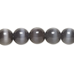 bead, cats eye glass, opaque black, 10mm round, quality grade. sold per 16-inch strand.