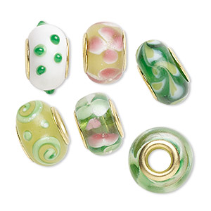 bead, dione, lampworked glass and gold-finished brass grommets, transparent green and opaque multicolored, 12x8mm-16x9mm rondelle with assorted designs, 4.5-5mm hole. sold per pkg of 6.