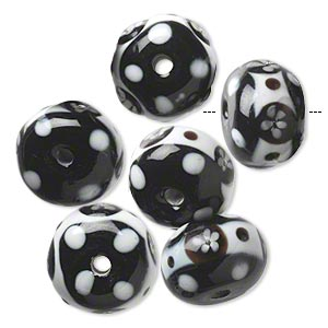 bead, lampworked glass, opaque white and black, 17x12mm rondelle with flower and dot design. sold per pkg of 6.