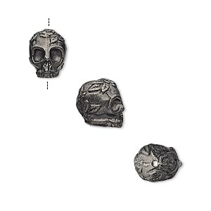 bead, tierracast, black-plated pewter (tin-based alloy), 10x8mm skull with rose and leaf design. sold individually.