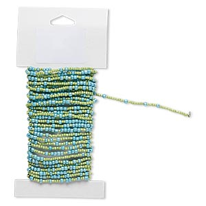 beaded wire, glass and brass, opaque luster turquoise light green, #9 and #6 round seed beads. sold per 15-foot card with hanging tab.