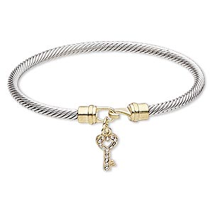 bracelet, bangle, czech glass rhinestone / gold-finished pewter (zinc-based alloy) / silver-plated brass, clear, 4mm twisted cable with 16x8mm key, 7-1/2 inches with hook-and-eye clasp. sold individually.