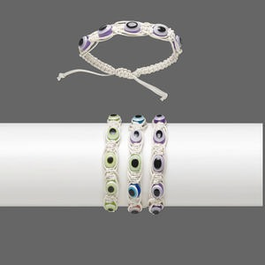 bracelet, waxed cotton cord and resin, white and multicolored, 12mm wide with 10x7.5mm oval and wards off the evil eye design, adjustable from 6-1/2 to 9 inches with wrapped knot closure. sold per pkg of 3.