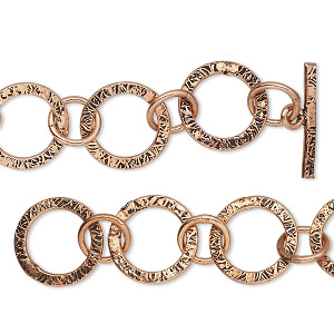 chain, antiqued copper, 15mm textured round link, 6-1/2 inches with toggle clasp. sold individually.