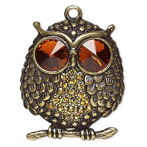 focal, glass rhinestone and antiqued brass-finished pewter (zinc-based alloy), orange and golden yellow, 38x33mm owl. sold individually.