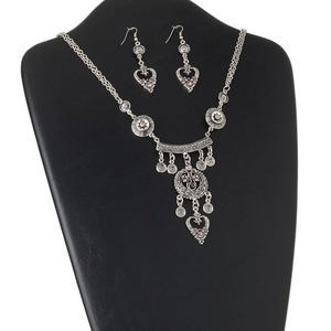 necklace and earring set, antiqued silver-finished pewter (zinc-based alloy), steel and glass rhinestones, silver and purple, 32x28mm fancy moon, 24-inches with lobster claw clasp, earrings with 30x20mm heart and fishhook earwires. sold per set.
