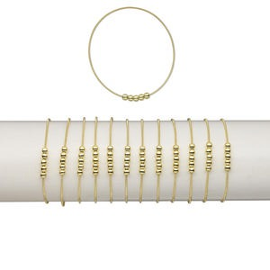 Bracelet, Stretch, Plastic Brass, Metallic Gold, Coil 4.5mm Round, 7 Inches. Sold Per Pkg 12 1471JU