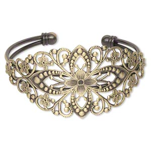 Bracelet, cuff, antiqued brass-finished brass, 35mm wide with filigree flower design, adjustable. Sold individually.
