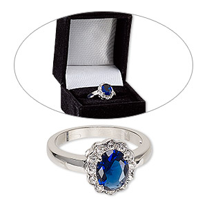 ring, cubic zirconia / glass / rhodium-finished brass, sapphire blue and clear, 13mm scalloped oval, size 8. sold individually.