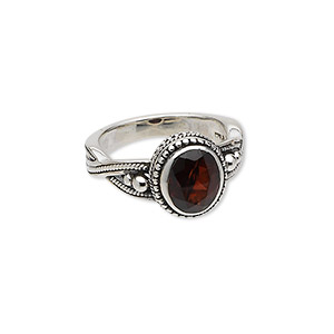 ring, garnet (natural) and antiqued sterling silver, 9x7mm faceted oval, size 6. sold individually.
