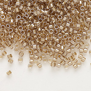 seed bead, delica, glass, color-lined champagne, (db907), #11 round. sold per 250-gram pkg.