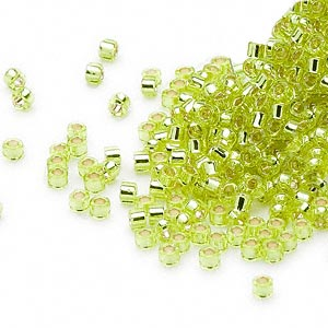 seed bead, delica, glass, silver-lined lime yellow, (db147), #11 round. sold per pkg of 250 grams.