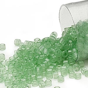 seed bead, delica, glass, transparent crystal light mint, (db1414), #11 round. sold per 7.5-gram pkg.