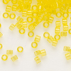 seed bead, delica, glass, transparent light yellow, (db1301), #11 round. sold per 50-gram pkg.