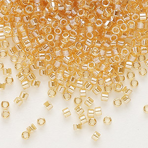seed bead, delica, glass, transparent luster light amber yellow, (db99), #11 round. sold per pkg of 250 grams.