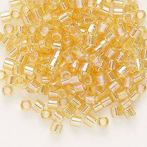 seed bead, delica, glass, transparent rainbow light topaz, (dbl100), #8 round. sold per 50-gram pkg.