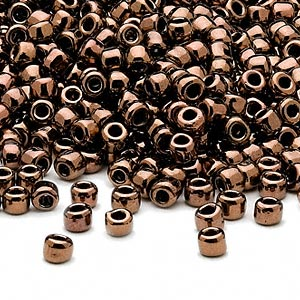 seed bead, dyna-mites™, glass, opaque iris bronze, #6 round. sold per 1/2 kilogram pkg.