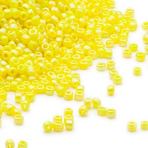 seed bead, dyna-mites™, glass, opaque rainbow yellow, #11 round. sold per 40-gram pkg.
