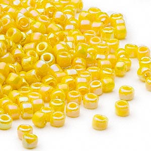 seed bead, dyna-mites™, glass, opaque rainbow yellow, #6 round. sold per 1/2 kilogram pkg.
