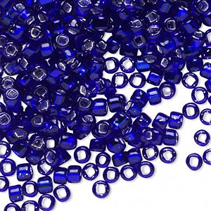 seed bead, dyna-mites™, glass, silver-lined translucent cobalt, #6 round with square hole. sold per 1/2 kilogram pkg.
