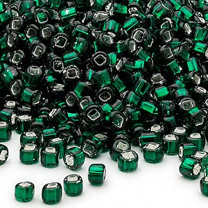 seed bead, dyna-mites™, glass, silver-lined translucent dark green, #6 round with square hole. sold per 40-gram pkg.