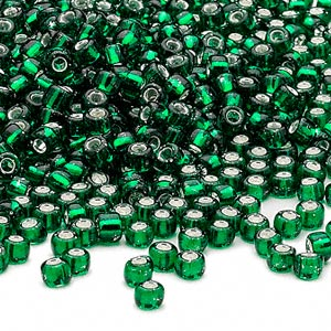 seed bead, dyna-mites™, glass, silver-lined translucent emerald green, #6 round. sold per 1/2 kilogram pkg.