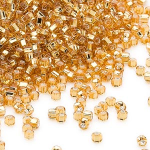 seed bead, dyna-mites™, glass, silver-lined translucent gold, #11 round with square hole. sold per 1/2 kilogram pkg.