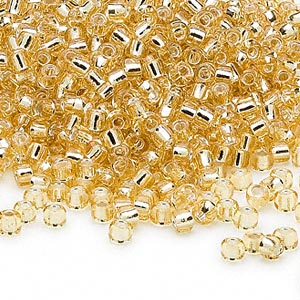 seed bead, dyna-mites™, glass, silver-lined translucent light gold, #8 round. sold per 40-gram pkg.
